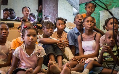 Watching The Magic Heart at a Port-au-Prince children's centre. The film can evoke difficult feelings, and is shown to small groups or individuals by facilitators skilled in counselling