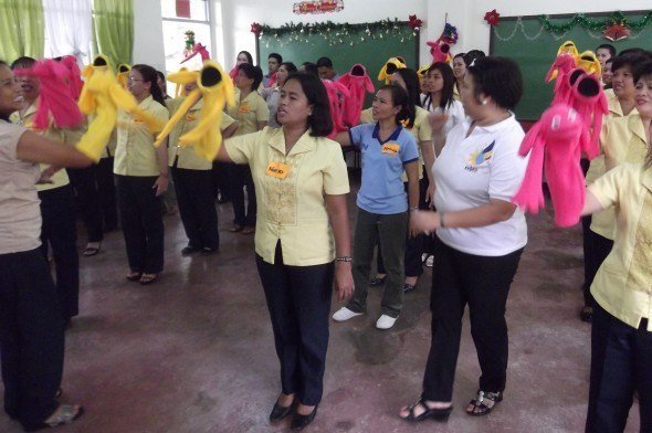 A school principal (white shirt) in Rizal, Philippines, teaching puppetry to local primary and secondary school teachers after attending a No Strings training of trainers workshop