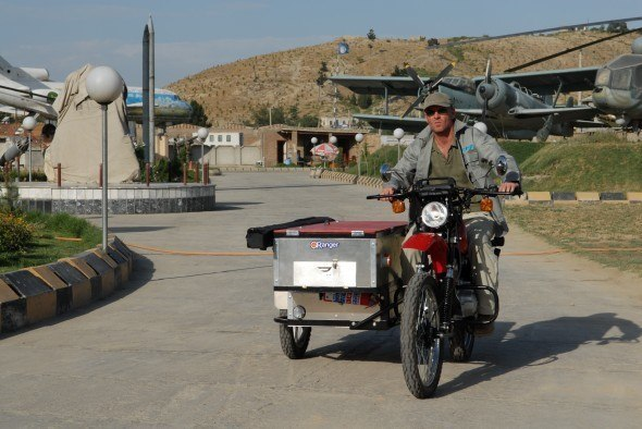 No Strings patron Hugo Speer test drives the eRanger cinema bike as the first two arrive in Kabul. The sidecar contains a large screen, projector and generator
