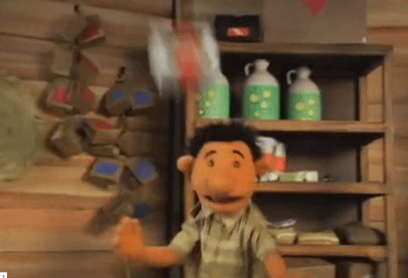 Scene from Earthquake: Badu is hit on the head from badly stacked items as the tremors begin