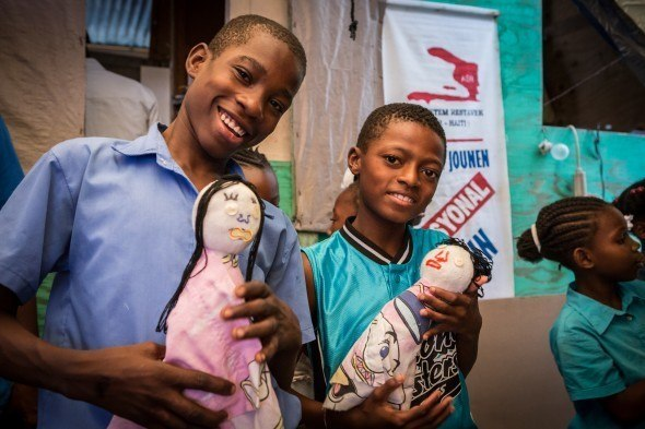 Like Jacques in The Magic Heart (below), these boys in Haiti have made puppets that can help them encourage their siblings to talk, with the help of trained facilitators, and express their own feelings