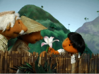 Scene from The Two Gardens: the Little Girl offers Popoy a flower as a symbol of friendship