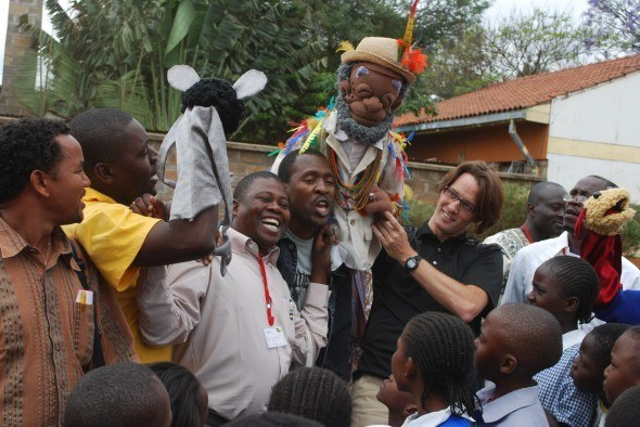 Nairobi school visit: HIV Workshop delegates test out their puppet skills with puppet trainer Ron Binion and star-of-the-show Kibing