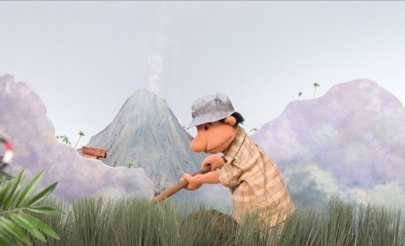 Scene from Volcano: Badu ignores warnings about the smoking volcano - it does it all the time, he says