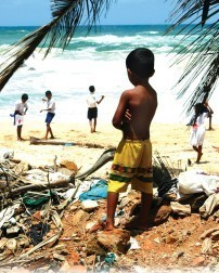 Watching friends play on a beach ravaged by the Asian tsunami. Credit: Clare Allen