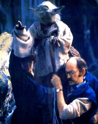 Kathy puppeteering Yoda's right hand alongside Frank Oz on the set of Star Wars. (c) All Rights Reserved, The Walt Disney Company