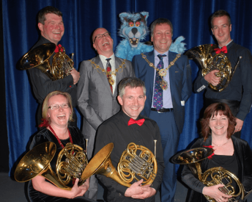 """With Harrogate mayor, deputy, and the horns section: """"My favourite part of the orchestra... """""""