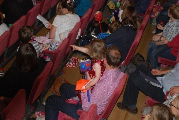 Some of the younger audience members, with puppets