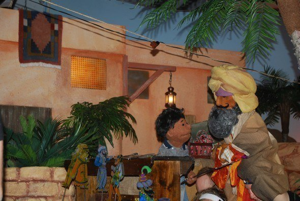 Scene from Out of the Shadows: After destroying the Puppet Man's screen, Wassam must help him put on a show