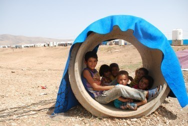 Fun and meaningful activities are vital for uprooted children like these at an IDP camp in Iraq, who have no idea what the future holds