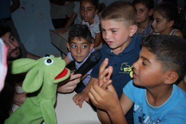 Syrian children tell 'Bob' (who hasn't quite understood) what the film is really about