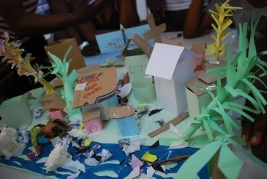 Discussing health problems associated with solid waste through a model made of a local area. What realistic solutions might young people  find?