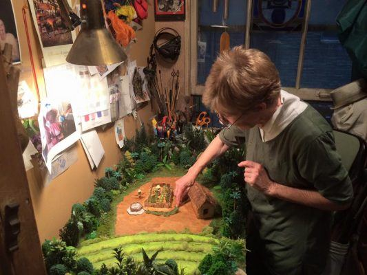 Kathy with some final touches to the little model that helps tell the story